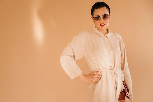 Woman in White Long Sleeve Dress Wearing Black Sunglasses