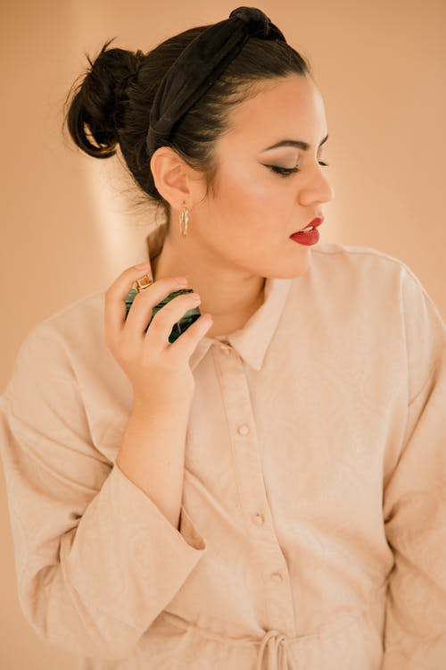Woman in White Button Up Long Sleeve Shirt