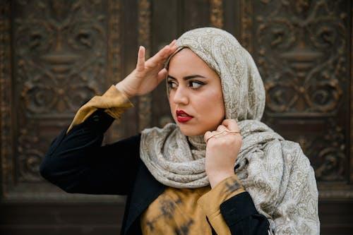 Woman Wearing Hijab and Black Long Sleeve Shirt