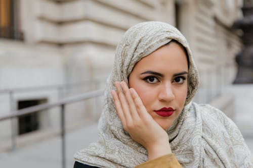 Woman in Beige Hijab and Gray Long Sleeve Shirt