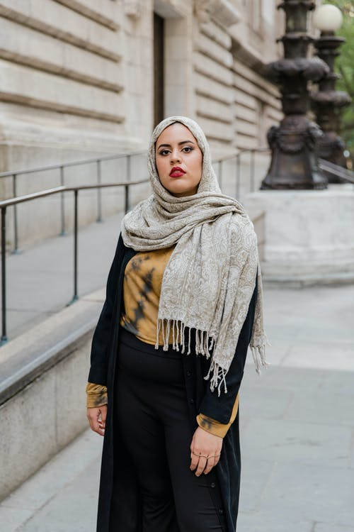 Woman Wearing Hijab and Black and Yellow Dress