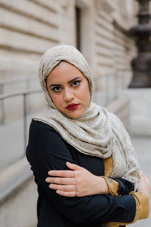 Woman in Black Long Sleeve Shirt and Hijab