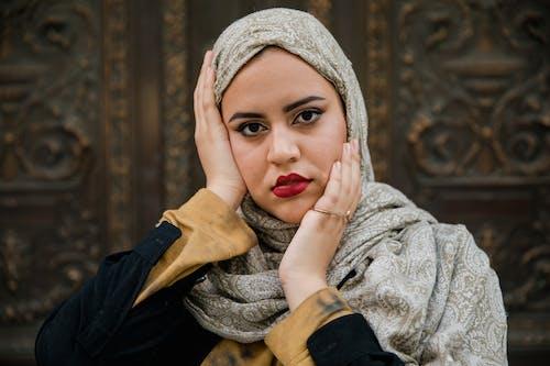 Woman Wearing Hijab Touching her Face