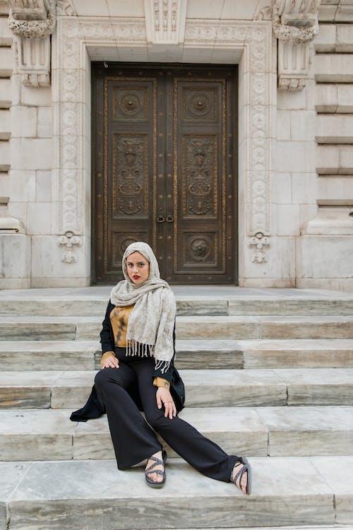 Woman Wearing Hijab Sitting on Concrete Stairs