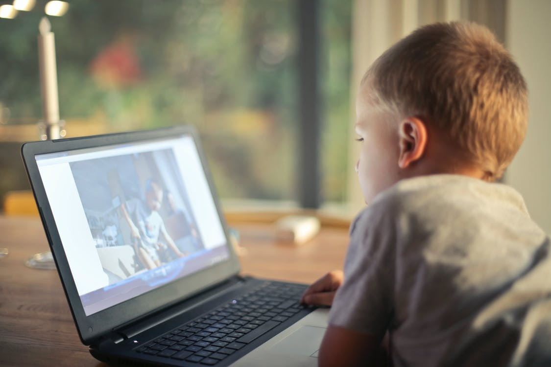 Boy Watching Video Using Laptop
