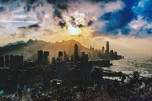 Bird's Eye View of City Near Ocean During Sunset
