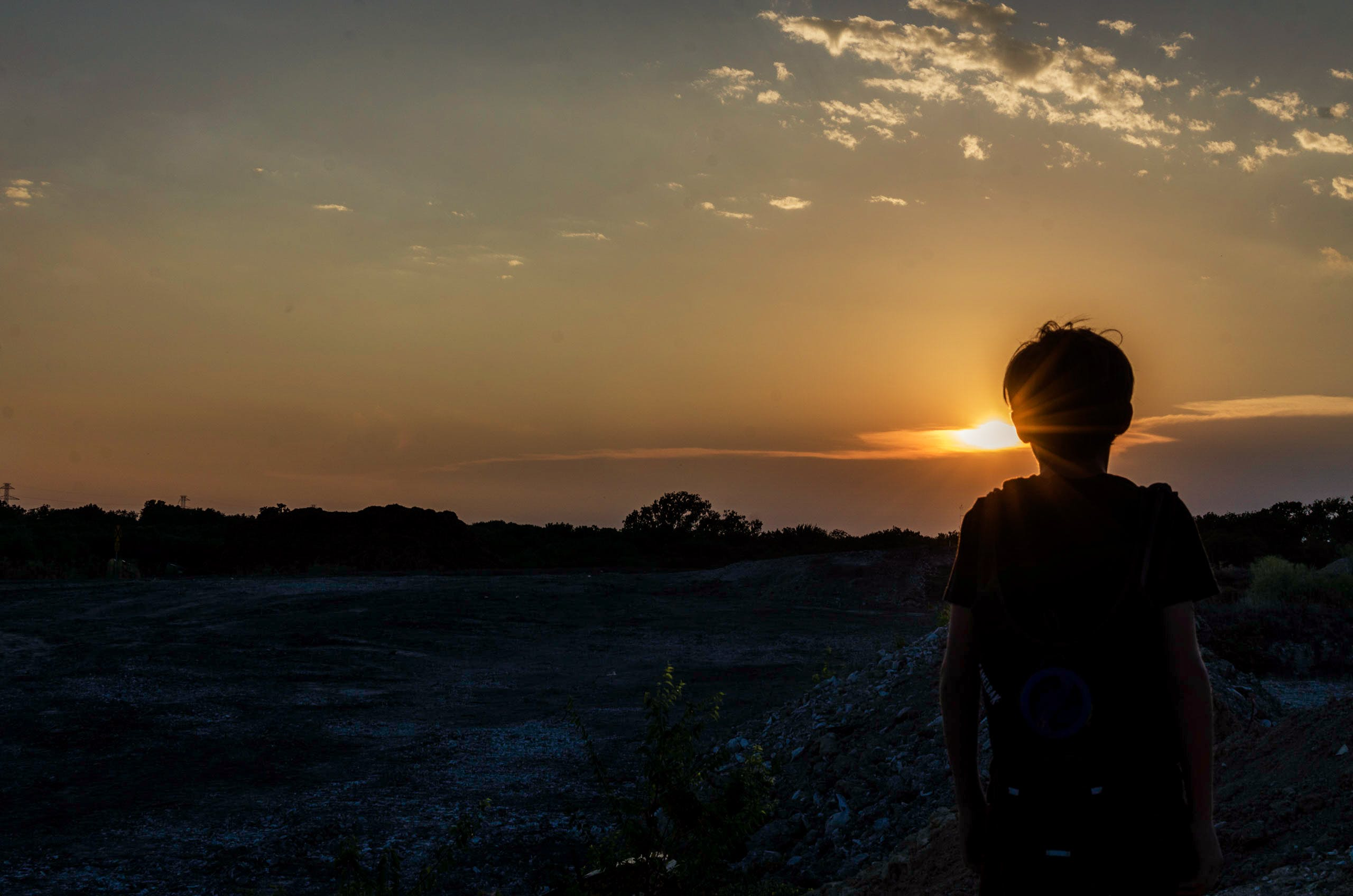 Silhouette of a Boy During Sunset
