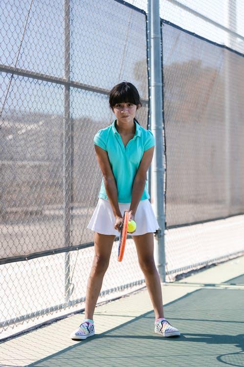 Girl Playing Tennis
