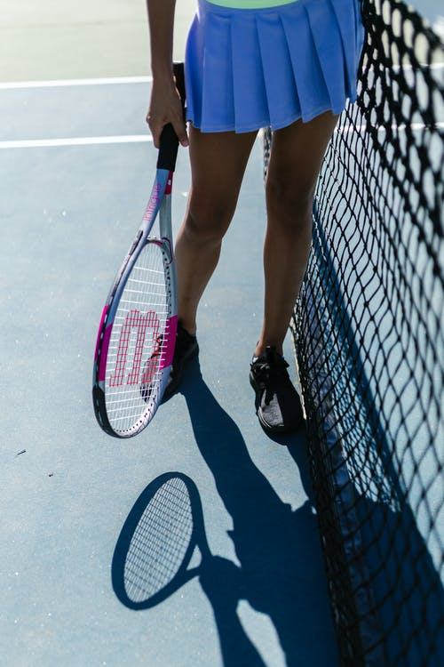 A Person Holding a Tennis Racket