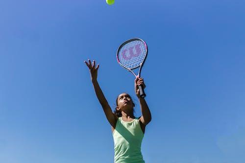 Low-Angle Shot of Girl Playing Tennis
