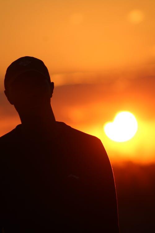 Silhouette of a Man Wearing Cap