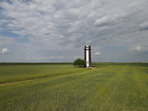 Tower in the Middle of Farm Field