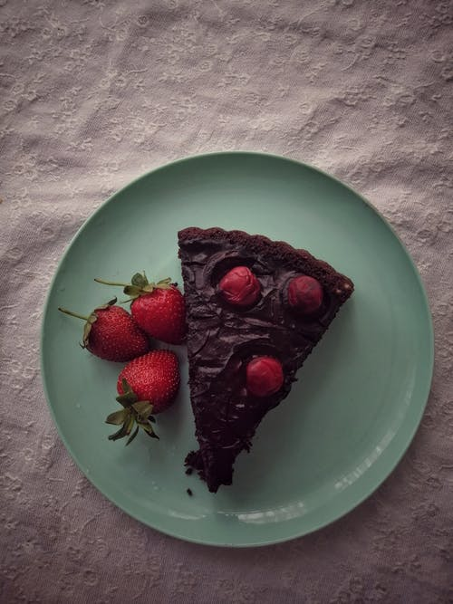Slice of Chocolate Cake and Red Strawberries