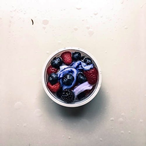 Flat Lay Photo of Berries in Container