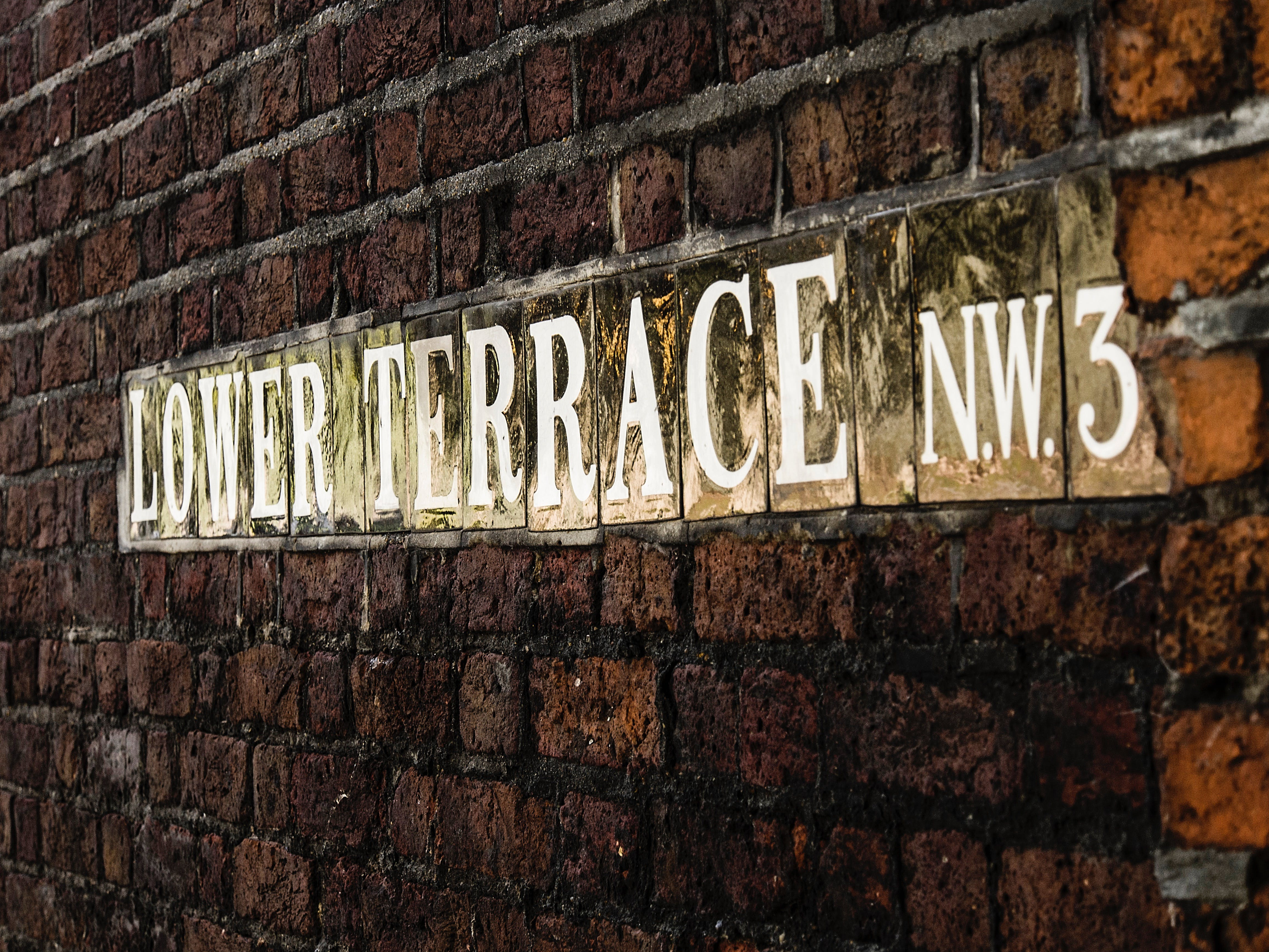 Lower Terrace Signage On Brick Wall