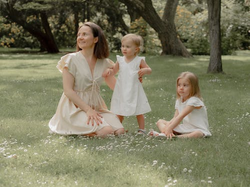 Mother and Daughters Enjoying in the Park