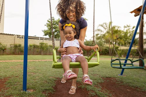 Mother and Daughter Playing on the Swing