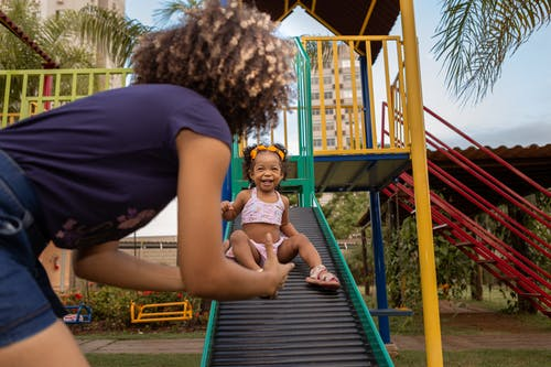 Mother and Daughter Enjoying the Play Ground