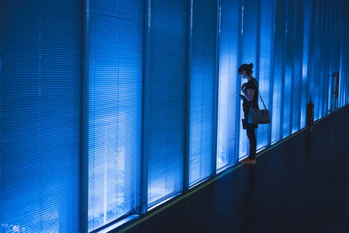 Woman Standing Near Blue Led Wall