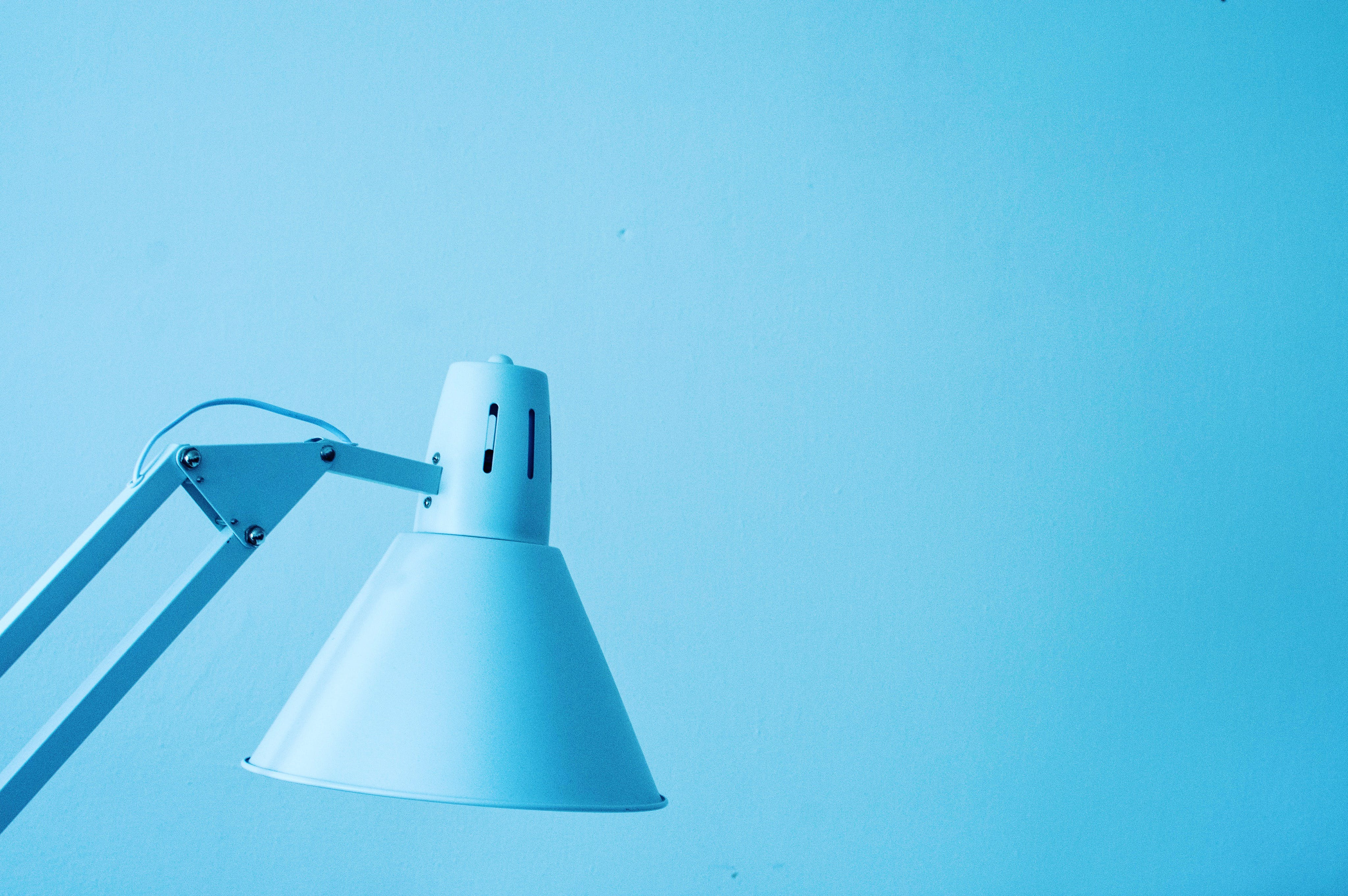 Close-Up Photography of White Desk Lamp