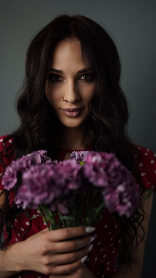 Pretty Woman Holding a Bouquet of Flower