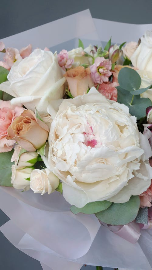 A Bouquet Of White And Pink Roses