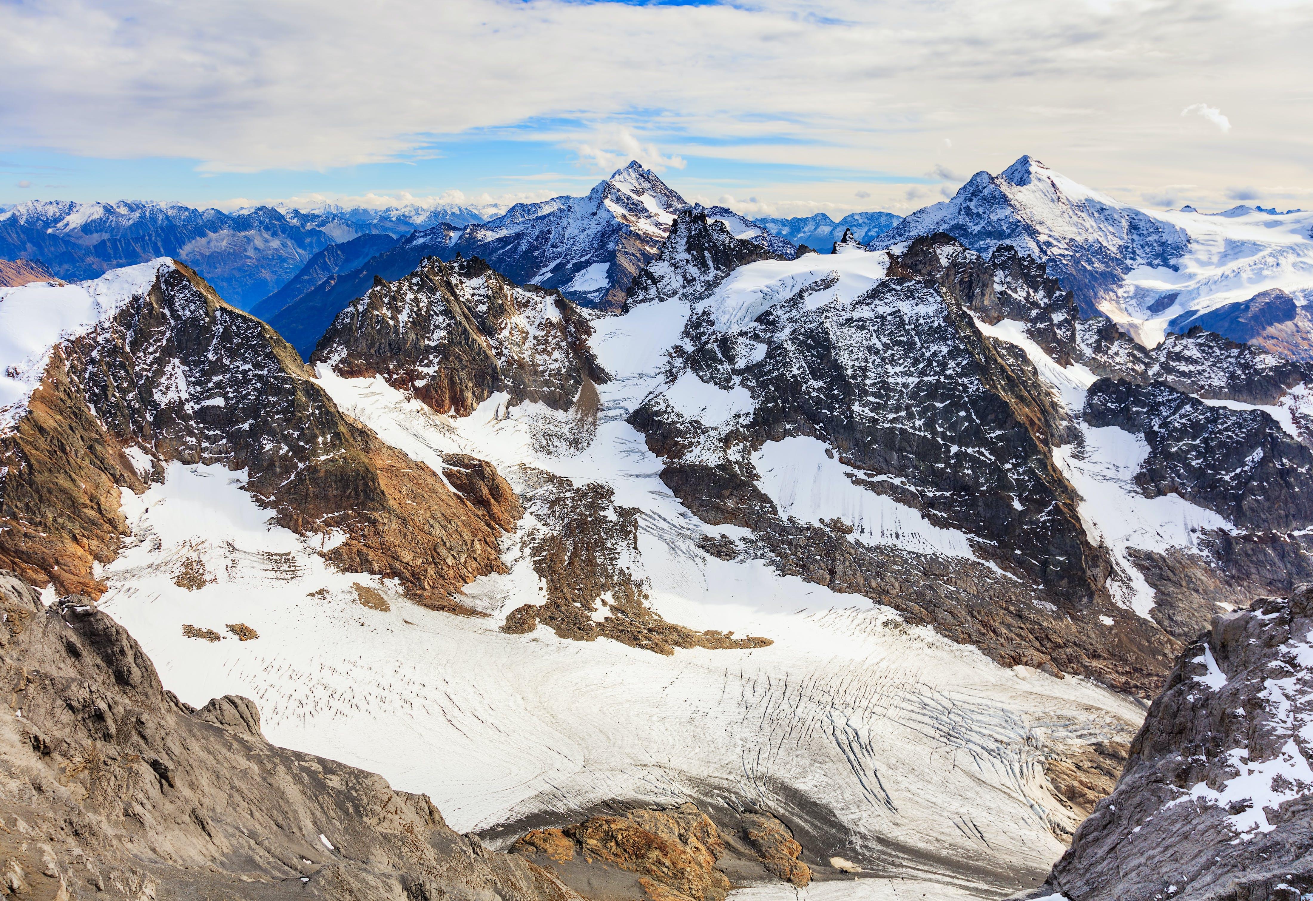 Brown Mountains Under White Sky