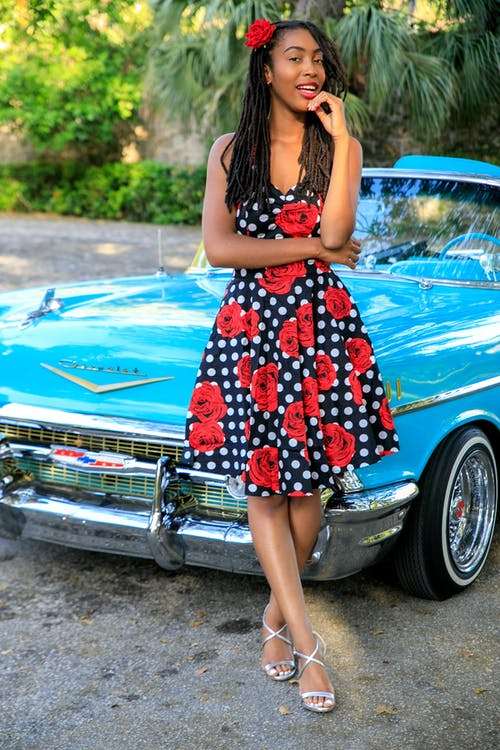 Pretty Woman Posing in Front of Classic Car