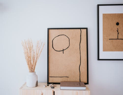 Framed Drawings Hanging on the Wall