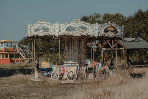 An Abandoned Carousel in a Grass Field
