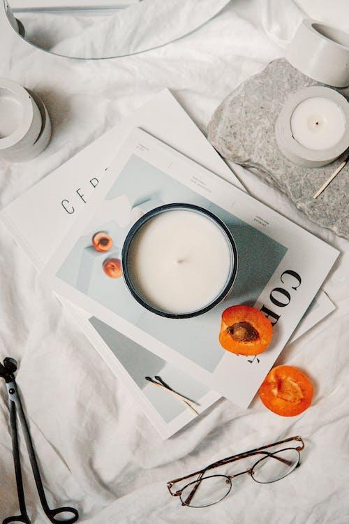 White Ceramic Mug on White Paper