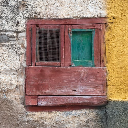 A Wooden Window on the Concrete Wall