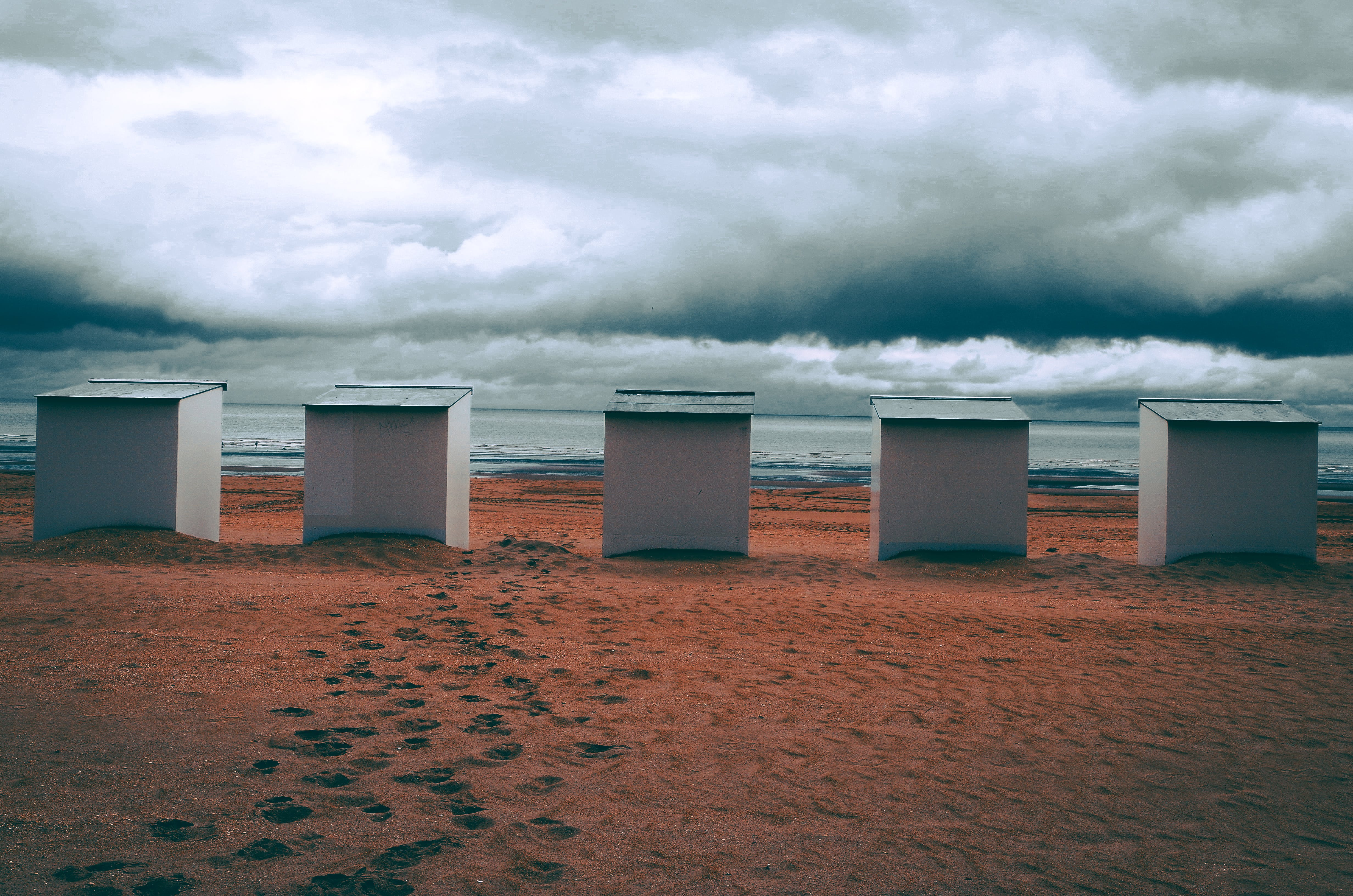Five White Frames Near Body of Water