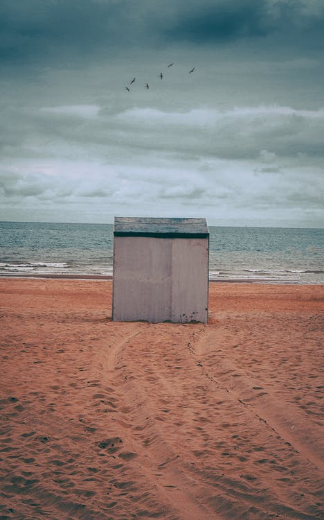Gray Storage Shed on Brown Sand