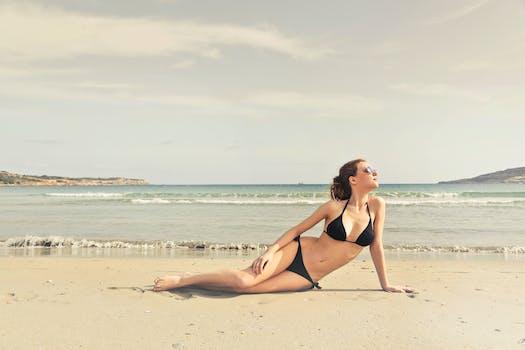Woman in Black Bikini on Seashore