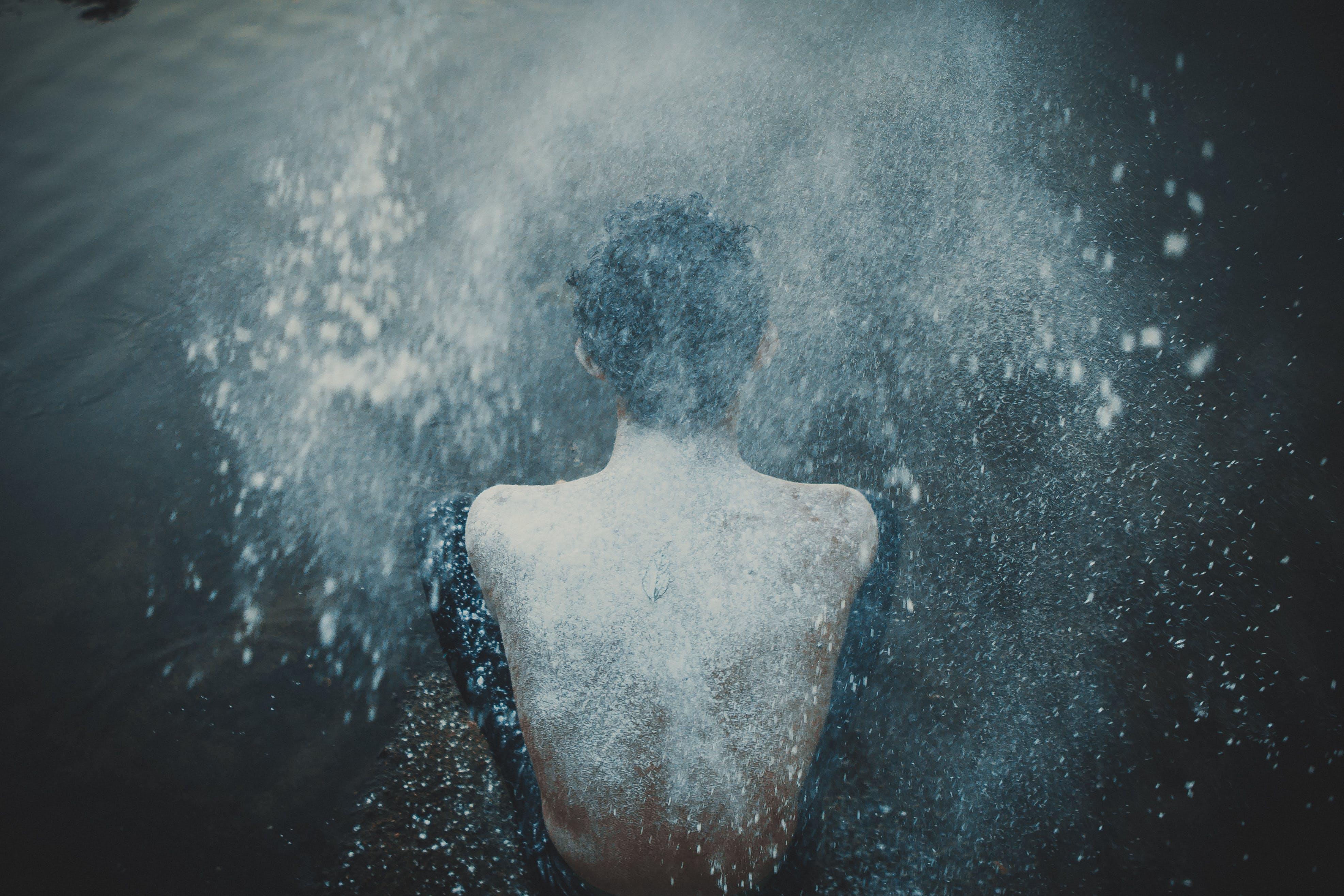 Person Splashing Powder on His Back