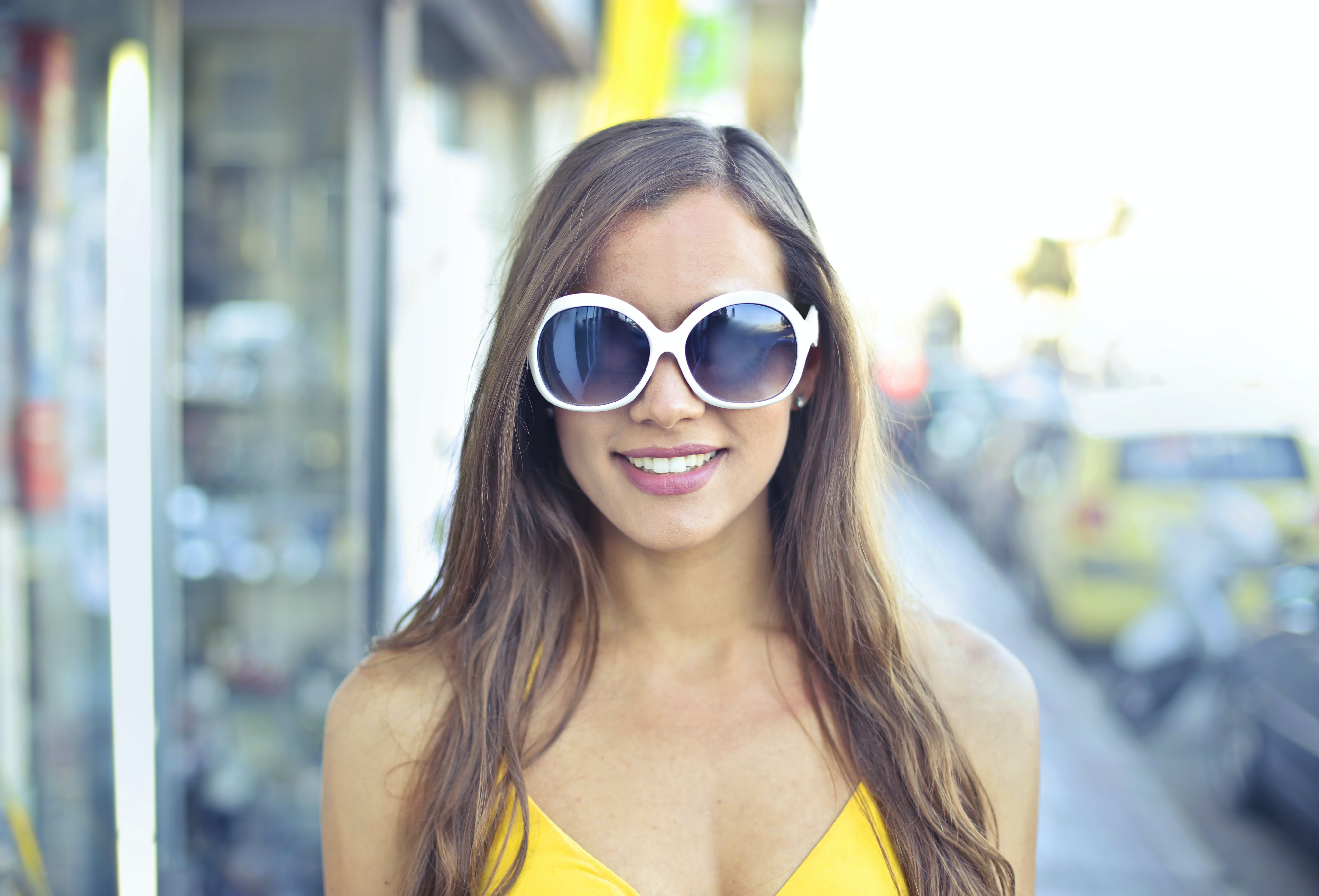 Woman Wearing Yellow Spaghetti Strap Top and Round Sunglasses