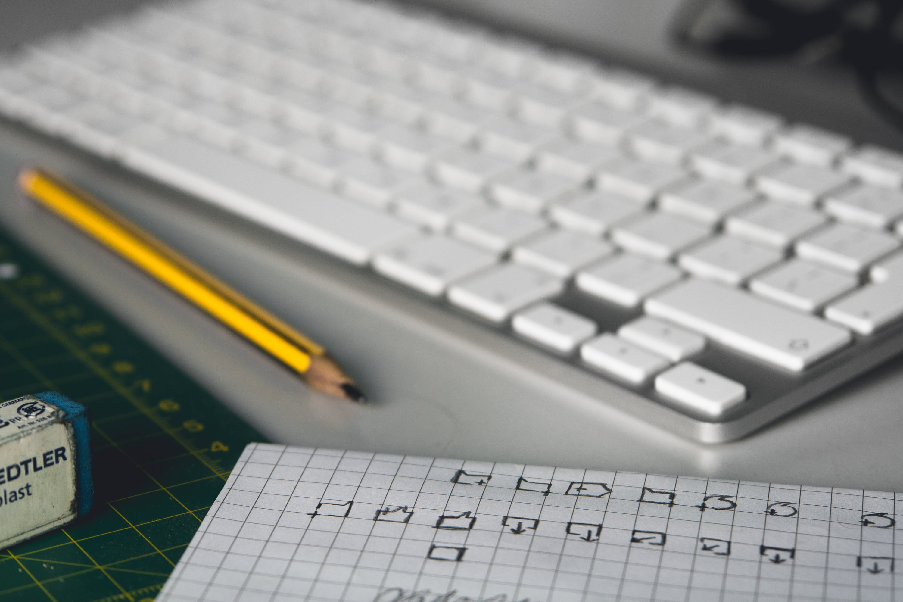 Apple Keyboard Near Black and Yellow Pencil on White Surface in Room