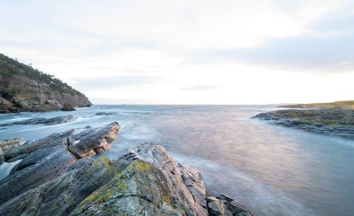 Foto profissional grátis de à beira-mar, água, águas, exposição longa
