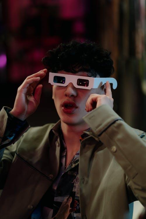 Man in Green Jacket Wearing a 3D Glasses