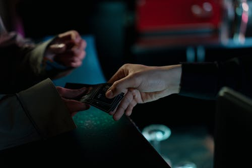 Person Holding Black Smartphone during Nighttime