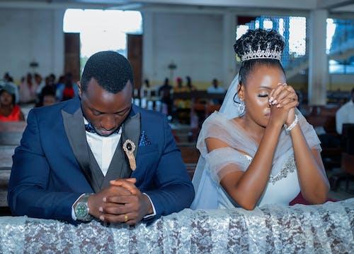 Man and Woman Praying on a Wedding
