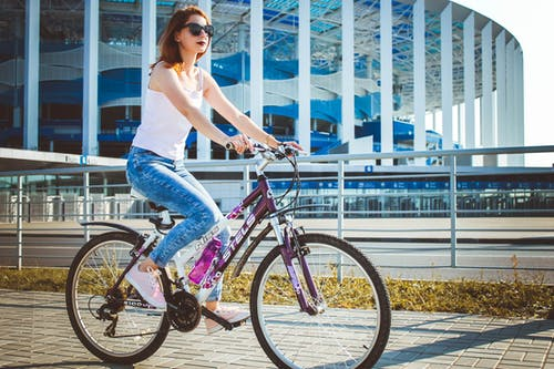 Woman riding bicycle in city