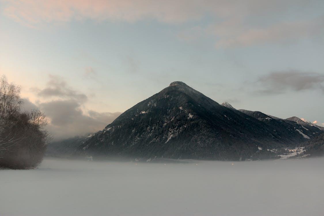 Black Mountain Under Cloudy Sky