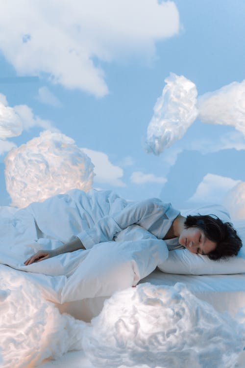 Photo of a Woman Dreaming of The Clouds in Her Sleep