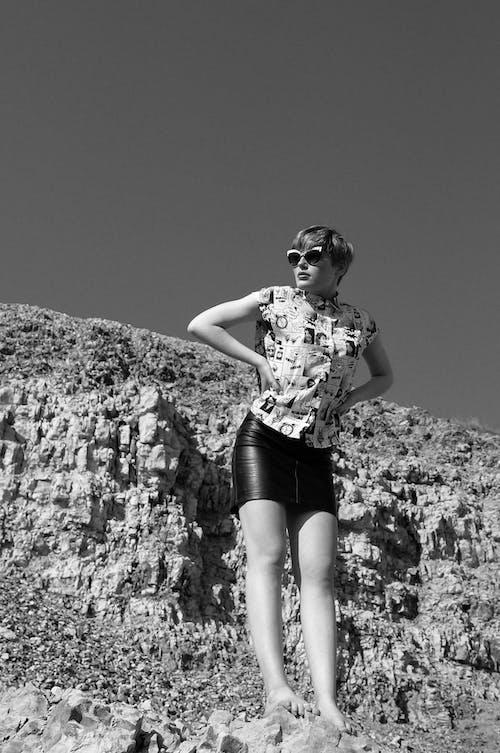 Stylish woman in modern sunglasses on highland