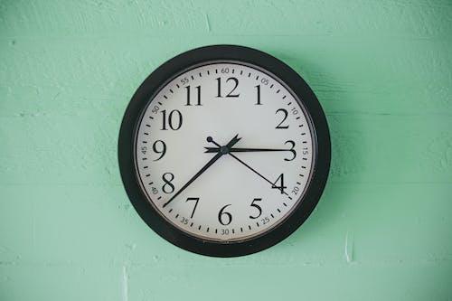 Close-Up Photo of a Black Round Analog Wall Clock