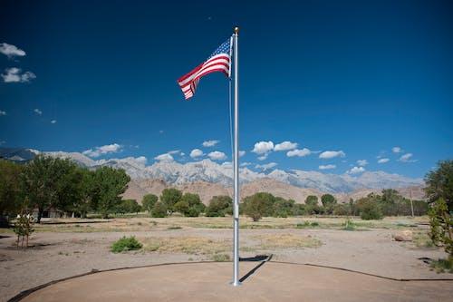 Free stock photo of american flag, eastern sierras, lone pine ca