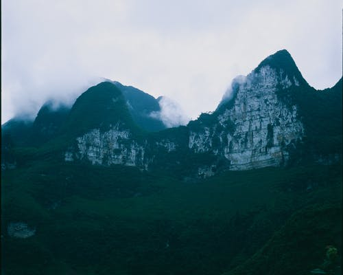 Green and Gray Mountains Under White Sky