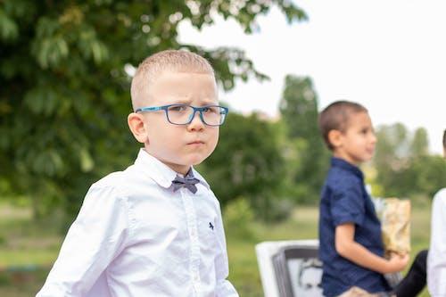 Boy in White Dress Shirt Wearing Eyeglasses